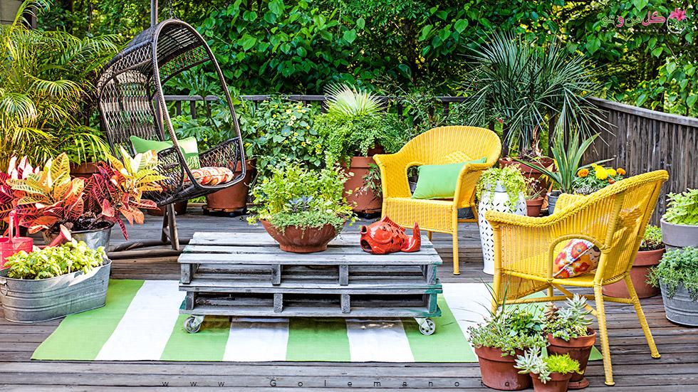 پاسیو زیبا با گل و گیاه آپارتمانی