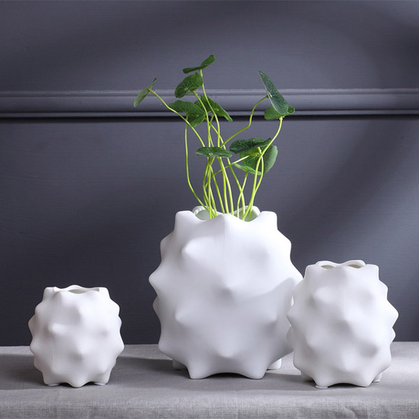 creative uneven porcelain flower vase modern white vase home ornaments accessories abstract irregular white ceramic گلدان های خاص مخصوص دکوراسیون خاص